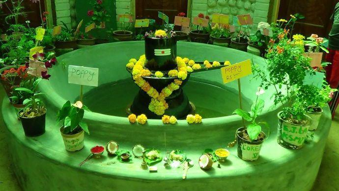 Centre of the building as temple: Shiva Lingam and flowers