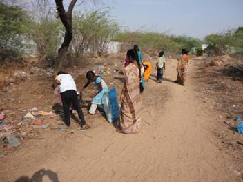 Students collecting garbage on the way to the school